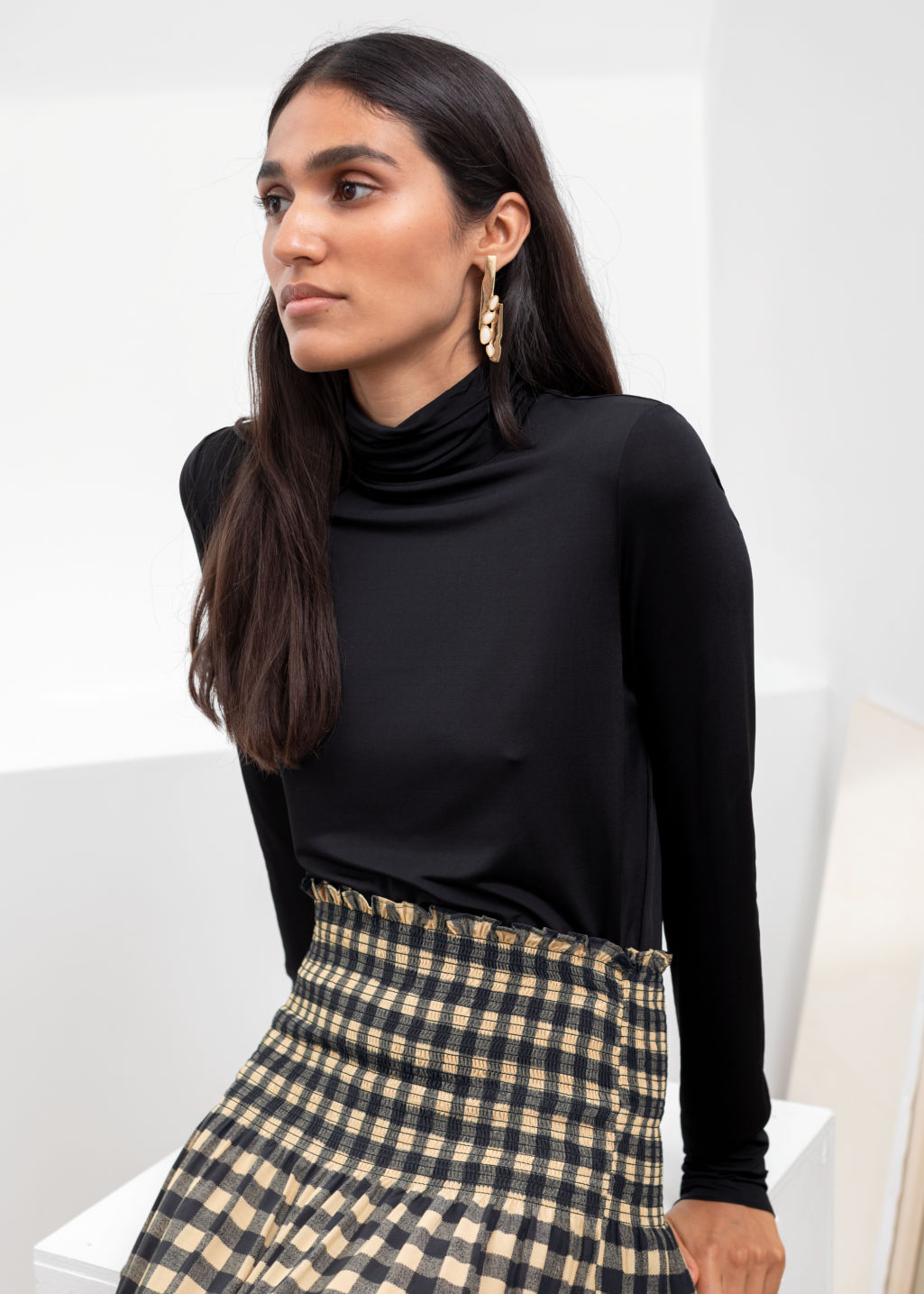 Model front image of Stories fitted stretch turtleneck in black