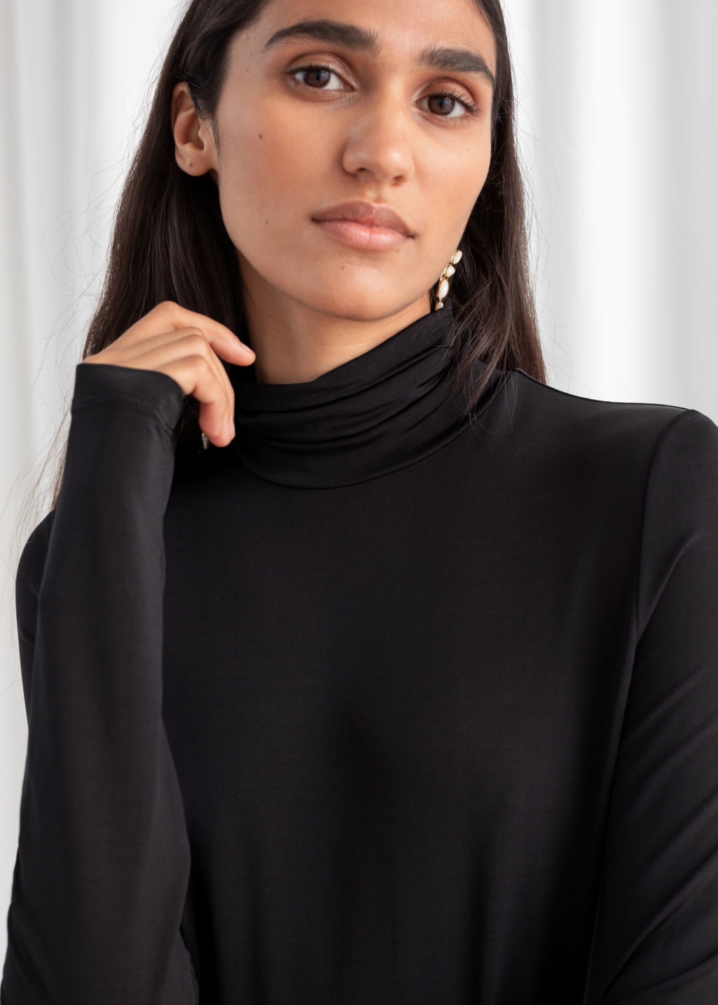 Model back image of Stories fitted stretch turtleneck in black