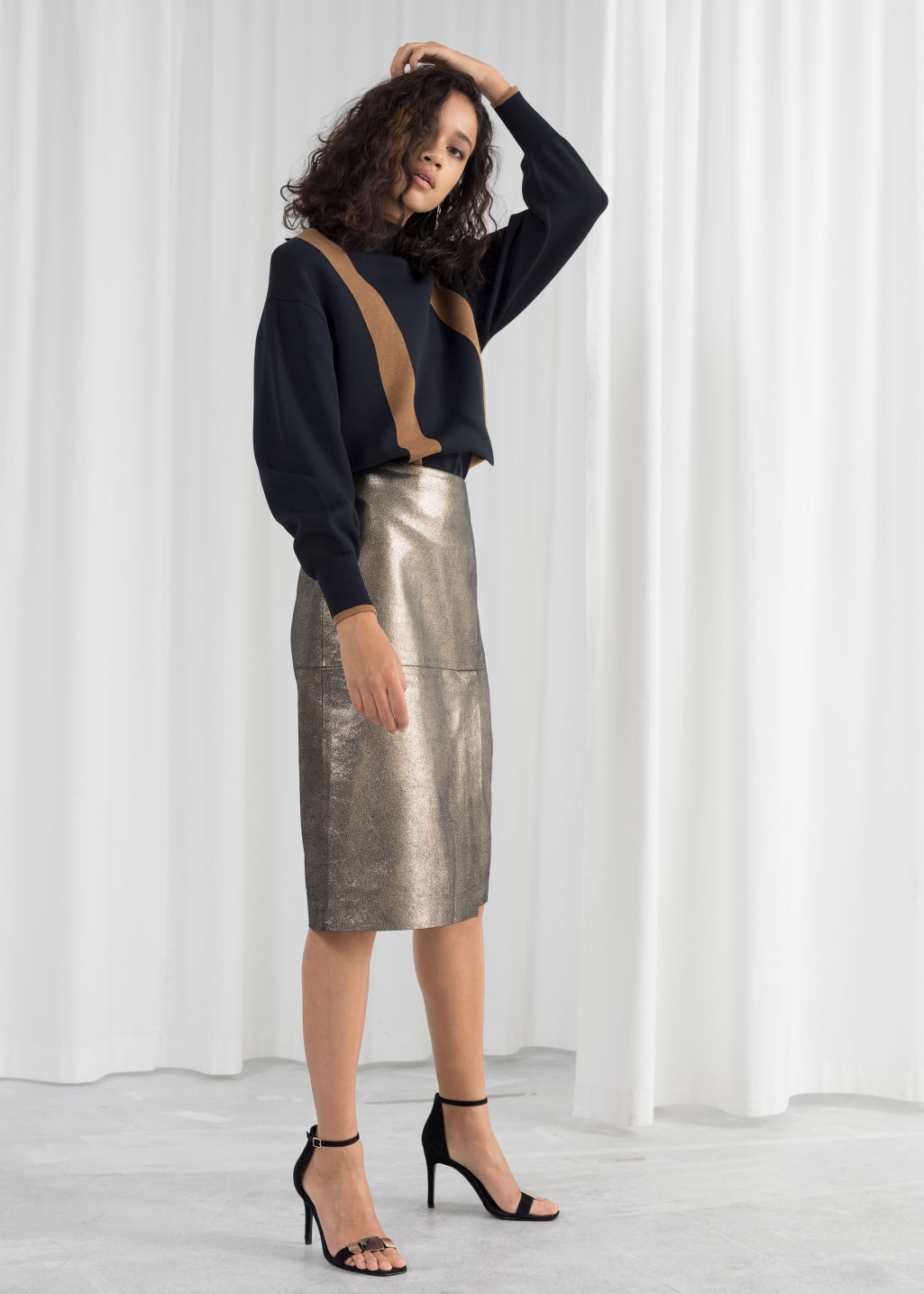 Model front image of Stories metallic leather pencil skirt in black