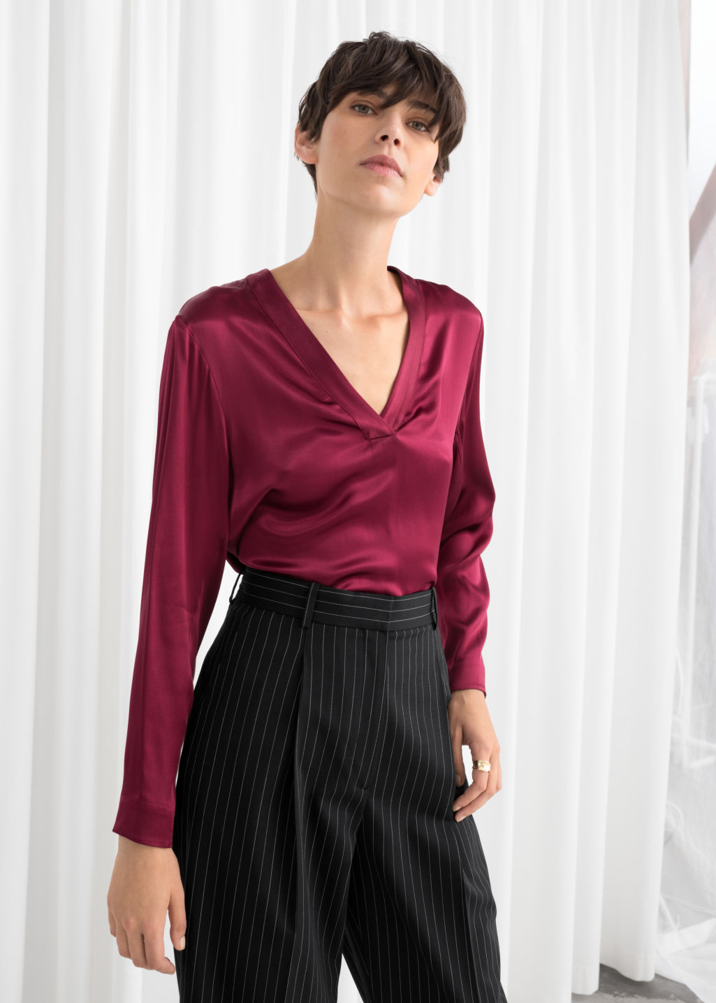 Model front image of Stories v-neck satin blouse in red