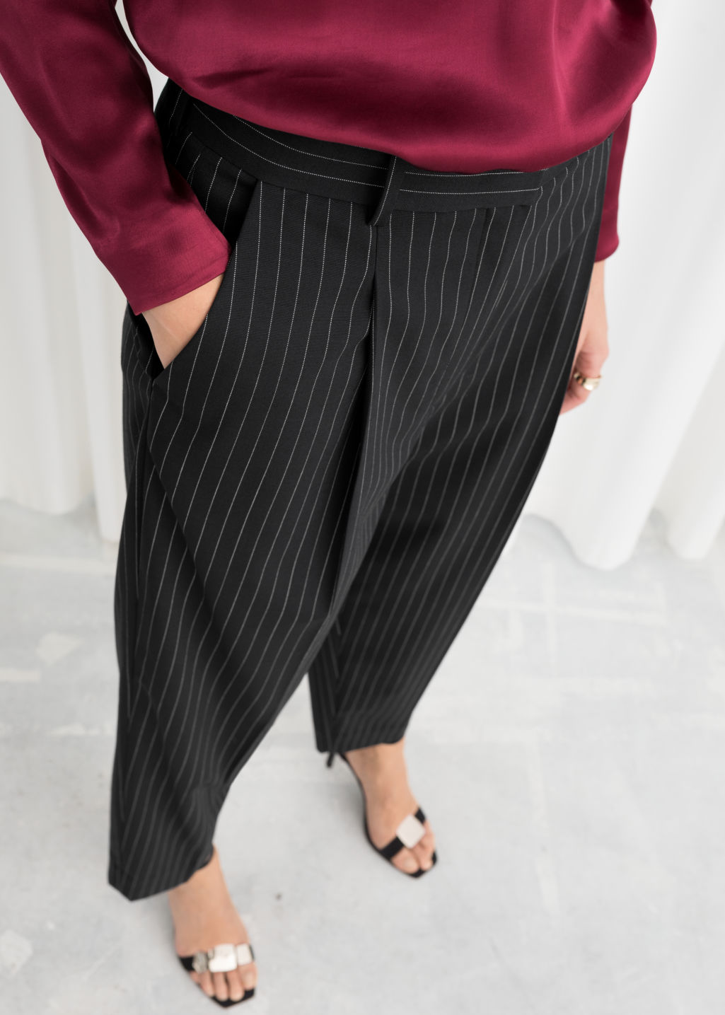 Model back image of Stories tapered varsity stripe trousers in black