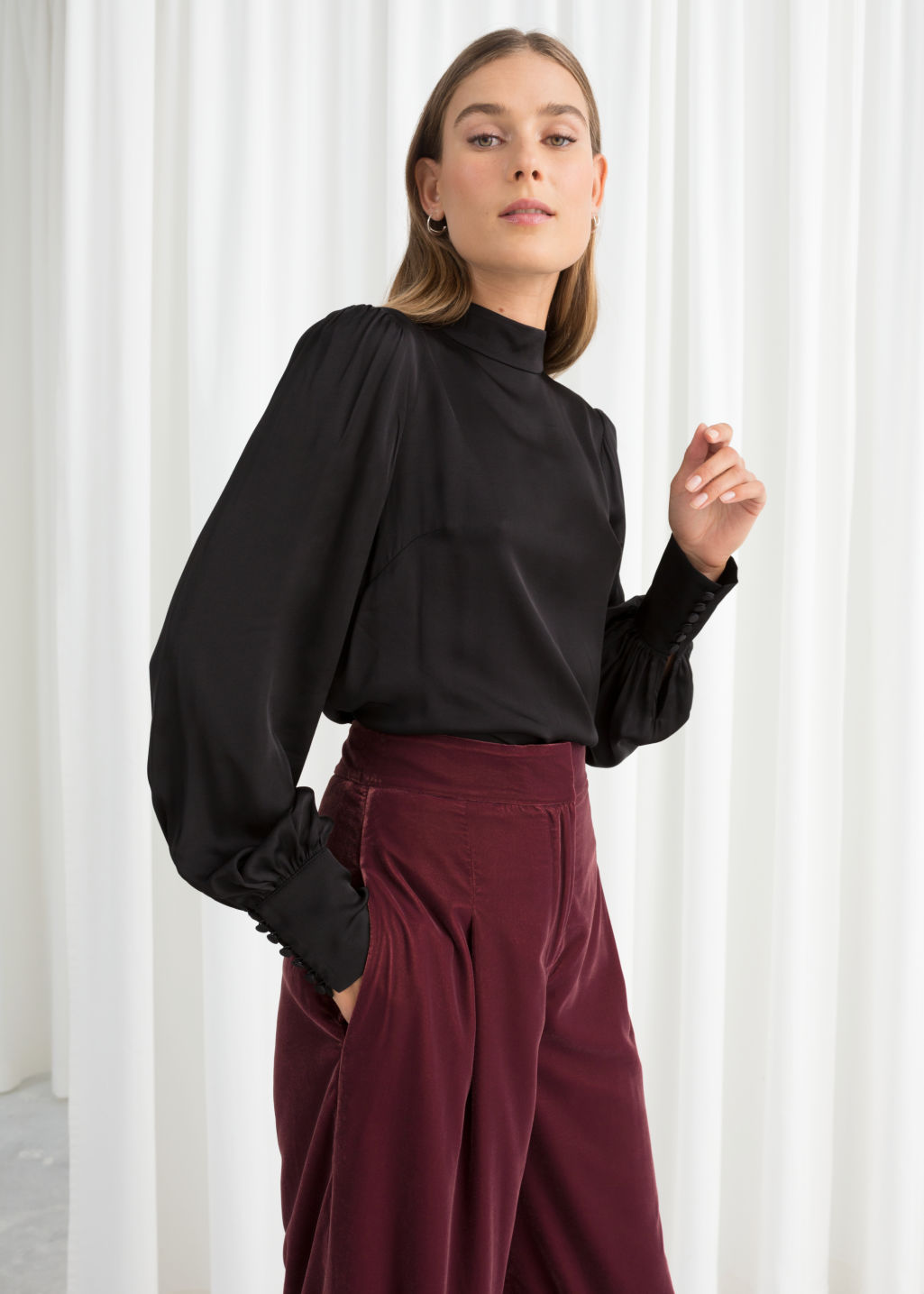 Model front image of Stories satin back tie blouse in black