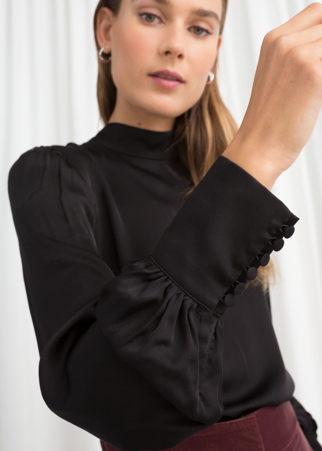 Model back image of Stories satin back tie blouse in black