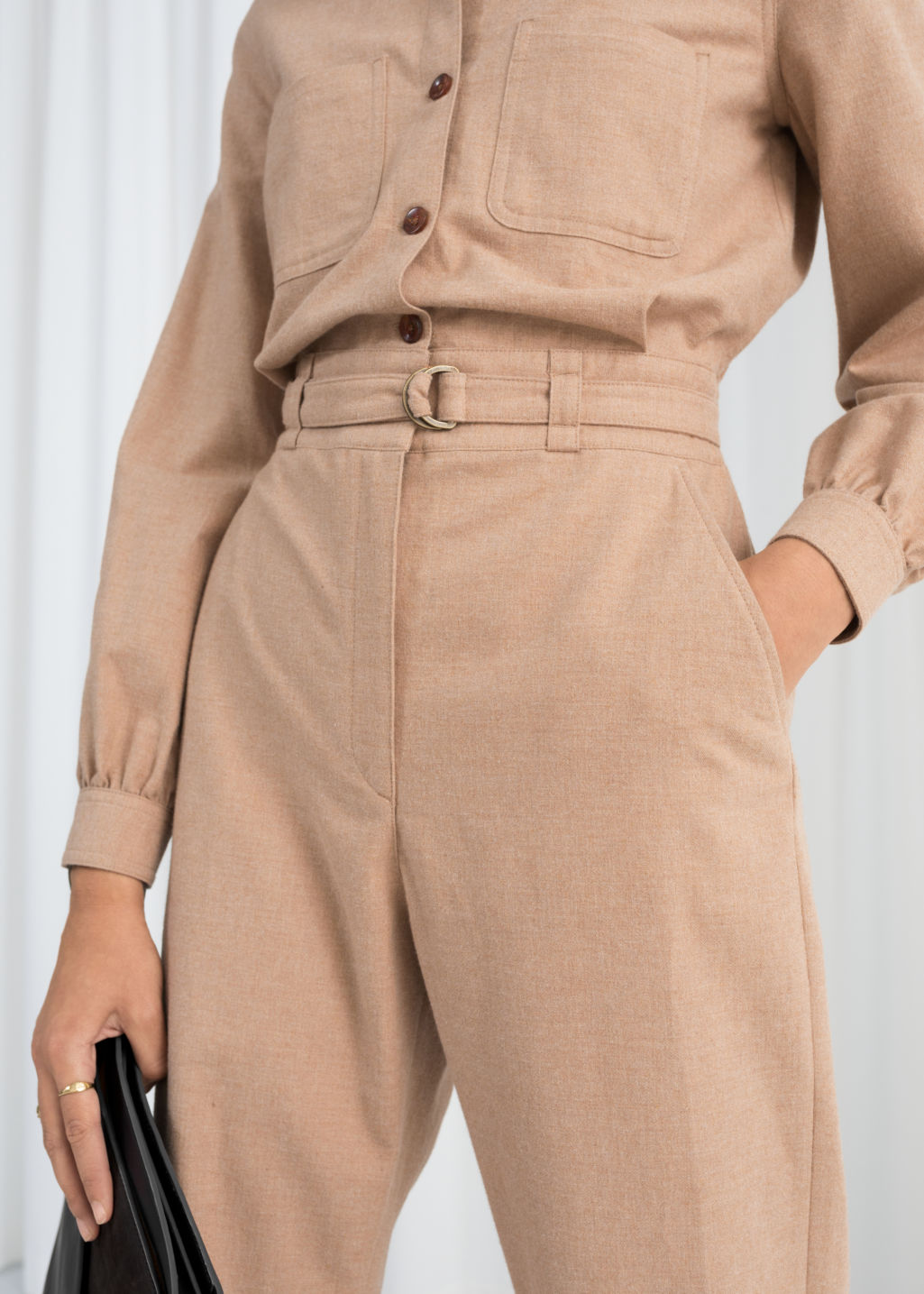 Model front image of Stories workwear boilersuit in beige