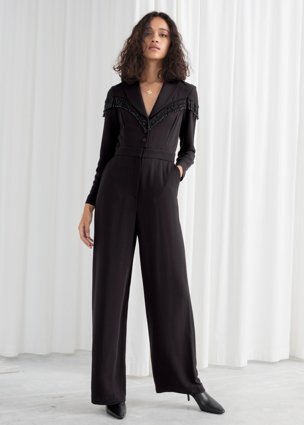 Model front image of Stories beaded long sleeve jumpsuit in black