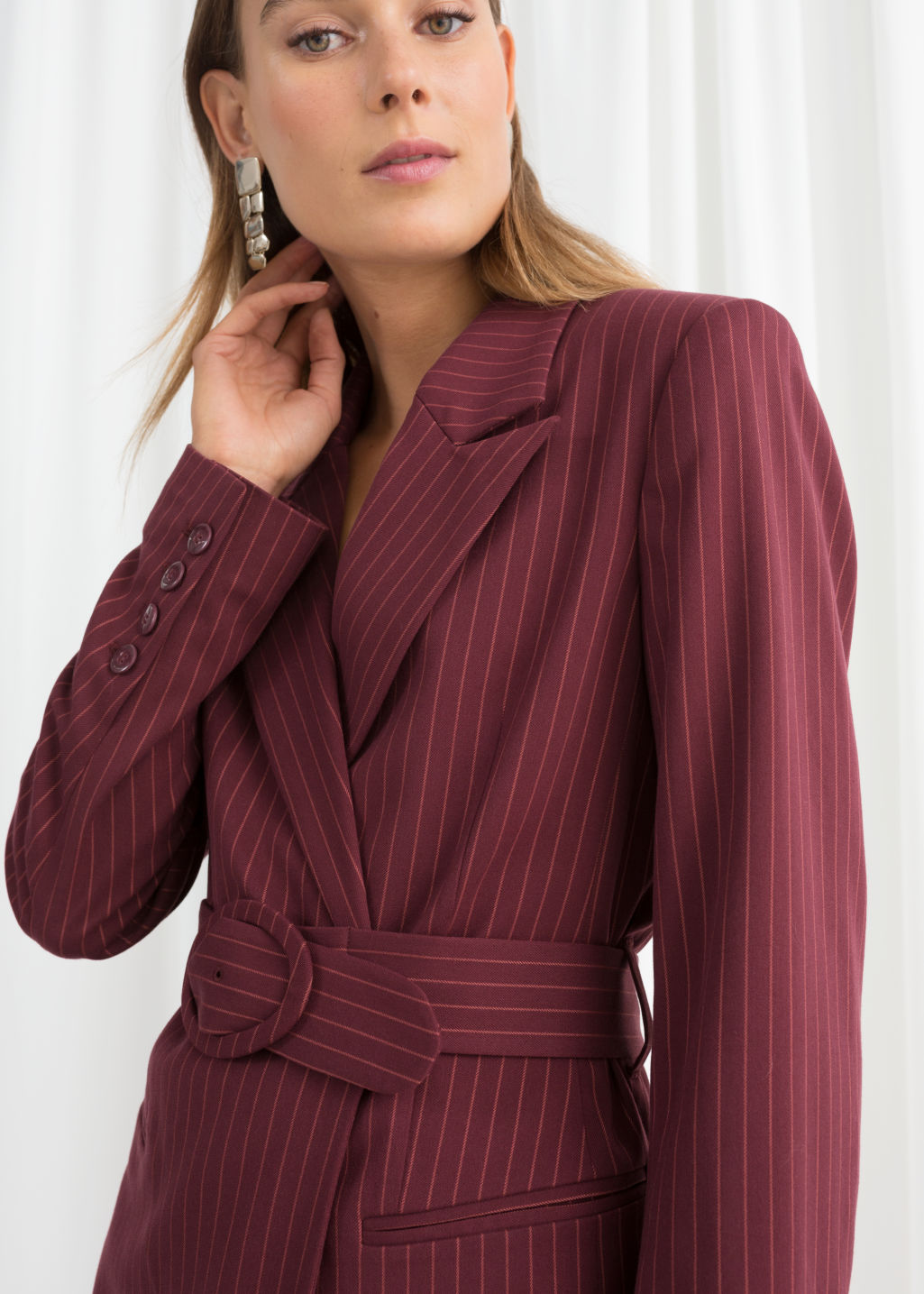 Model front image of Stories belted pinstripe blazer in red