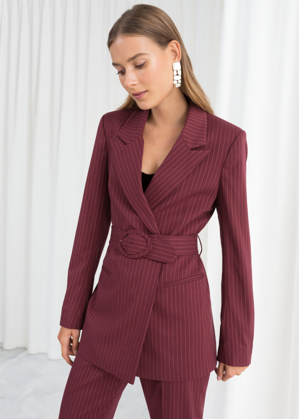 Model back image of Stories belted pinstripe blazer in red