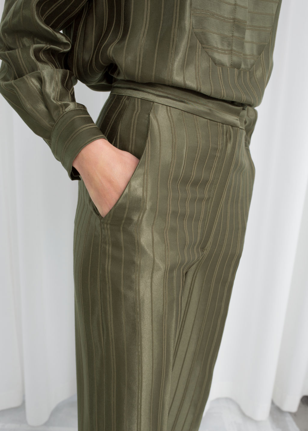 Model back image of Stories tailored jacquard stripe trousers in green