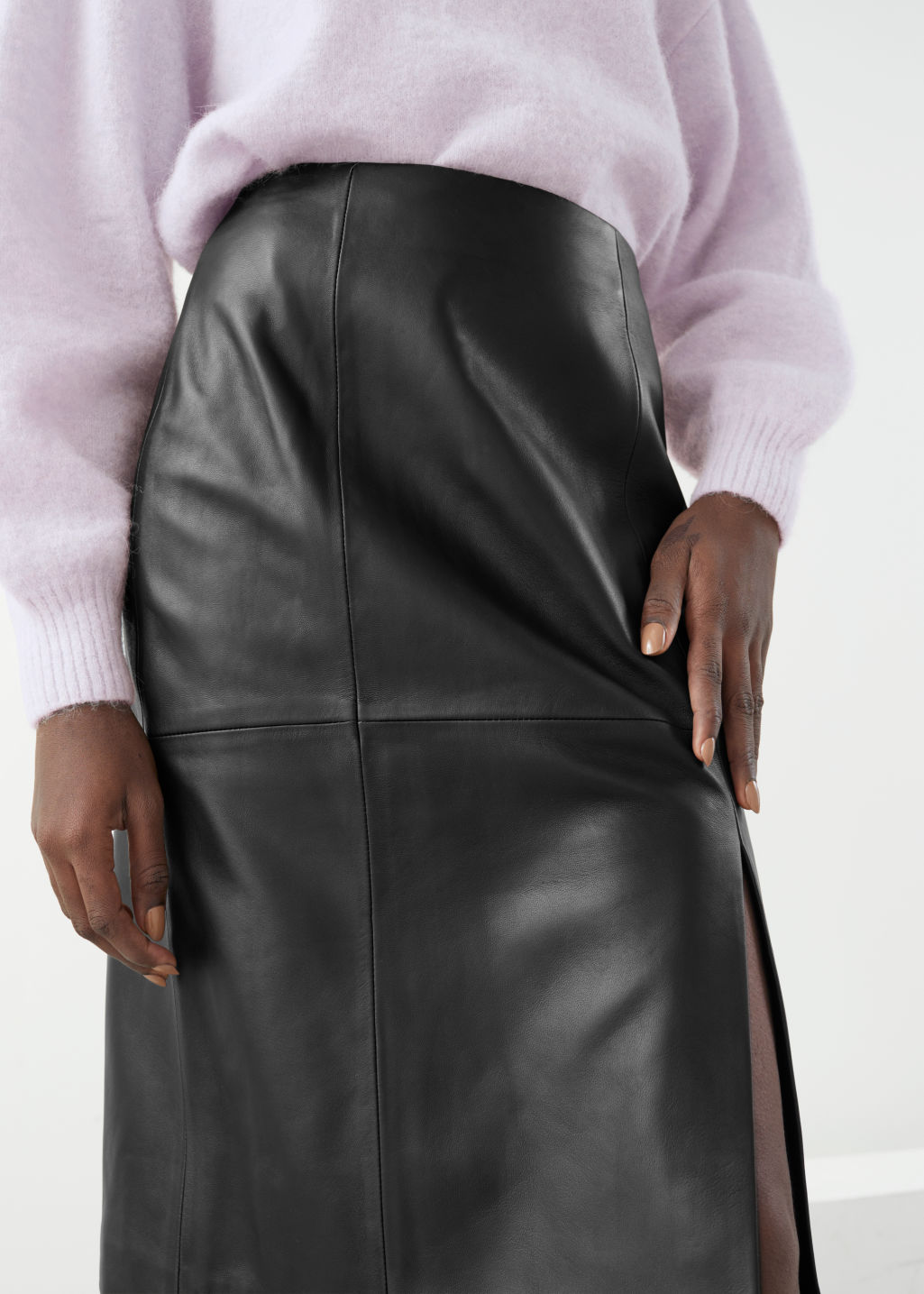 Model front image of Stories midi leather pencil skirt in black