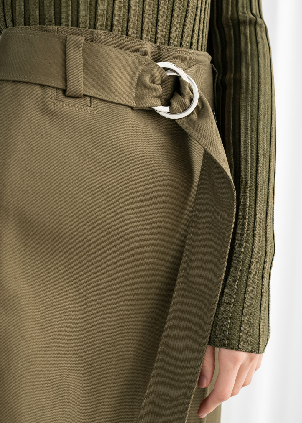 Model back image of Stories belted a-line midi skirt in green
