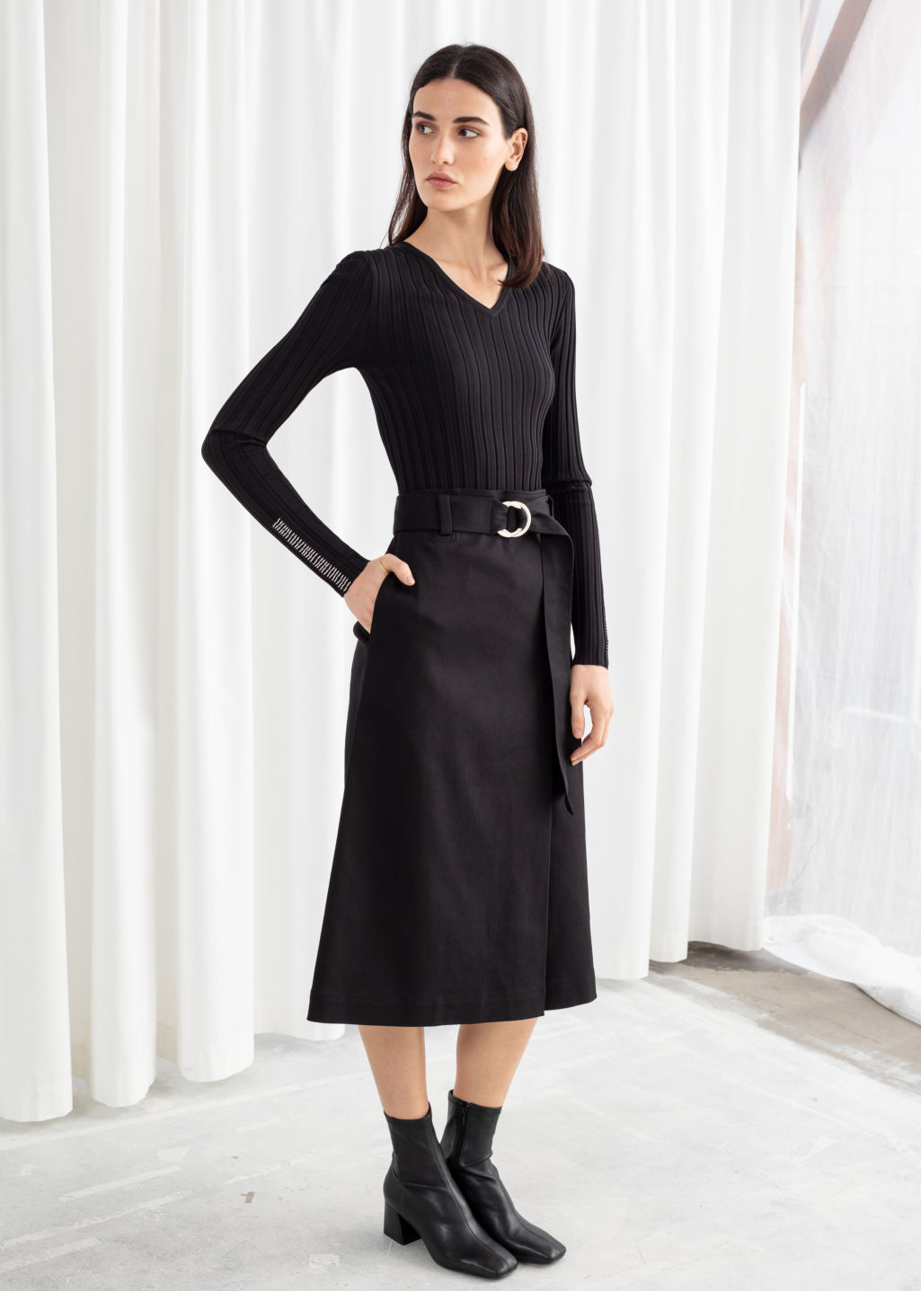 Model front image of Stories belted a-line midi skirt in black