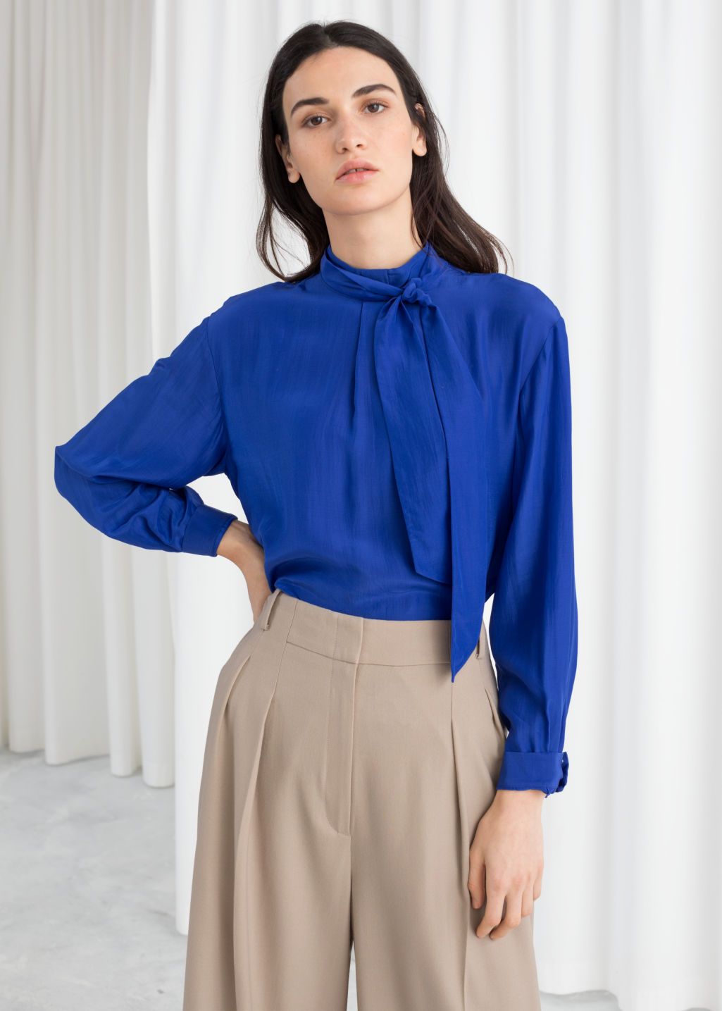 Model front image of Stories straight fit pussy bow blouse in blue