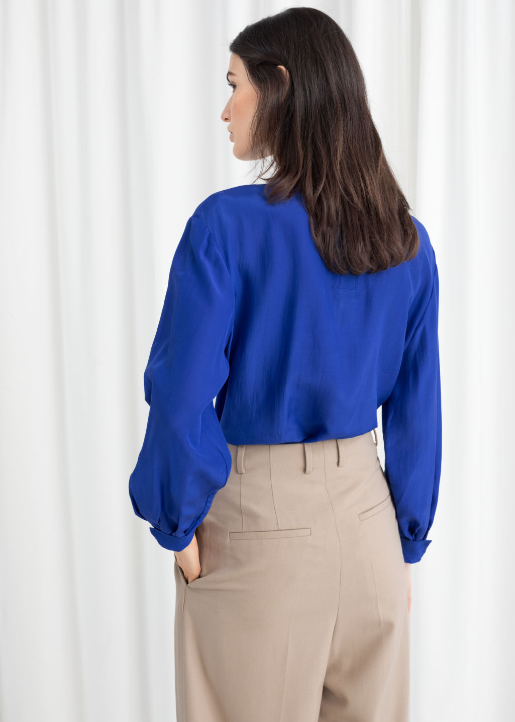 Model back image of Stories straight fit pussy bow blouse in blue