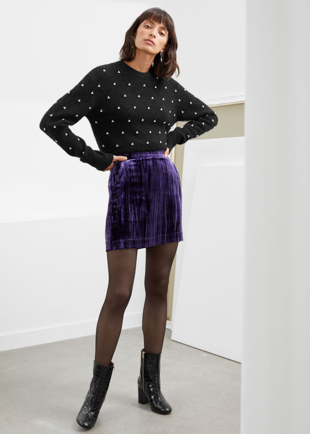 Model front image of Stories velvet mini pencil skirt in purple