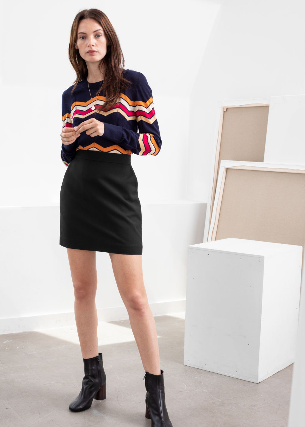 Model front image of Stories velvet mini pencil skirt in black