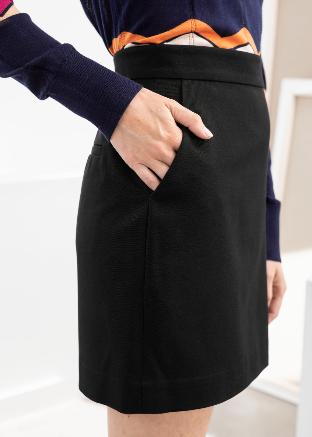 Model back image of Stories velvet mini pencil skirt in black