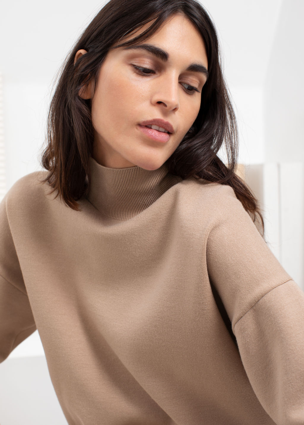 Model back image of Stories oversized micro knit turtleneck in beige