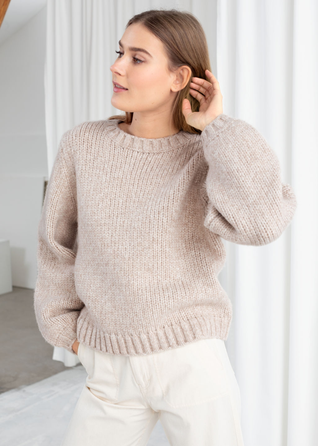 Model front image of Stories cropped wool blend sweater in beige