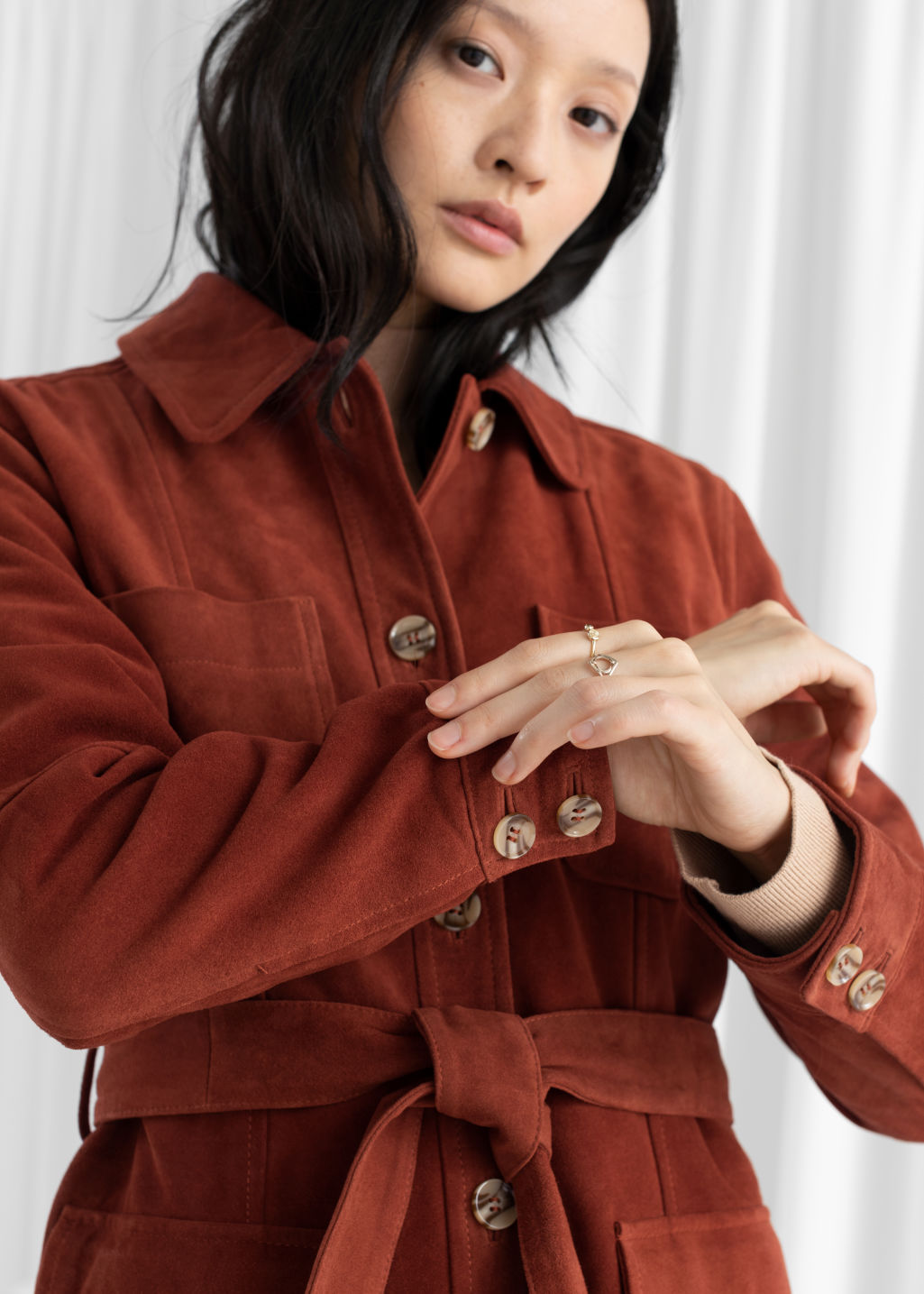 Model front image of Stories belted suede workwear jacket in orange