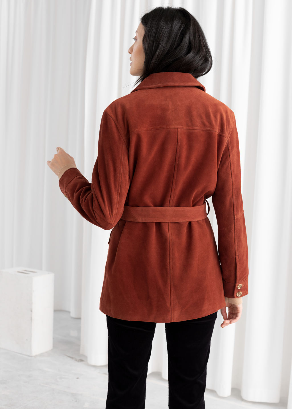 Model back image of Stories belted suede workwear jacket in orange