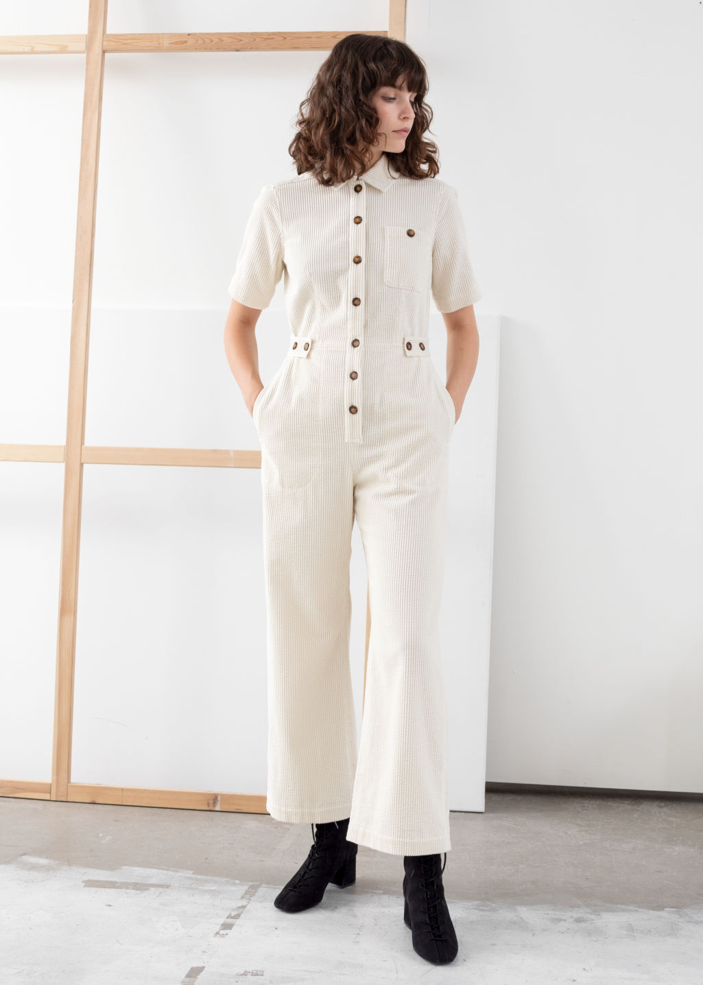 Model front image of Stories corduroy boilersuit in white