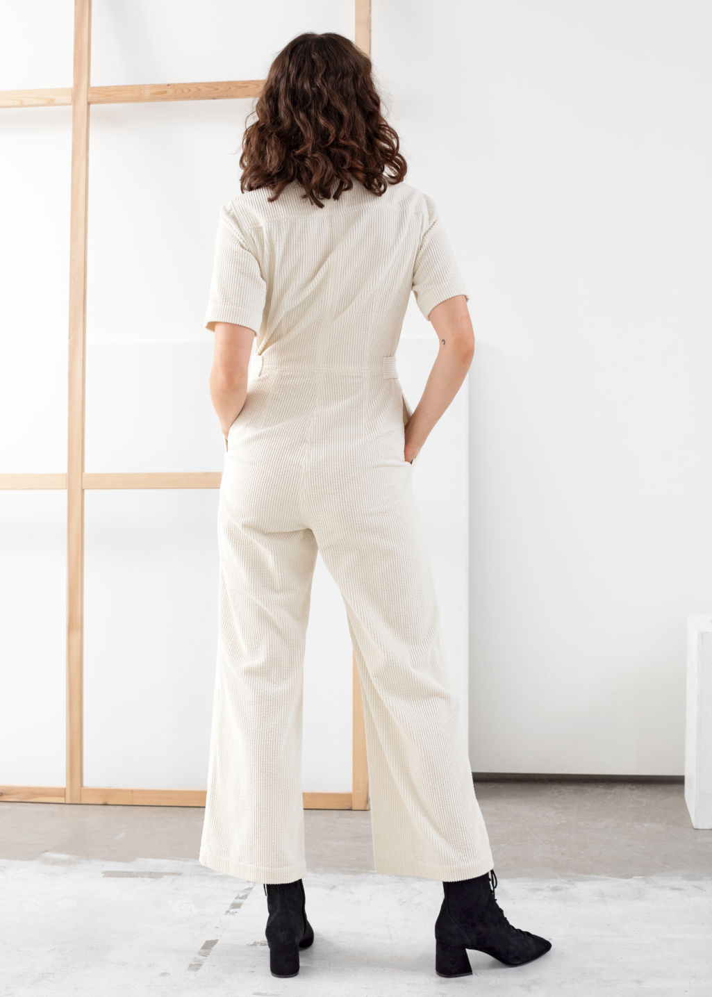 Model back image of Stories corduroy boilersuit in white