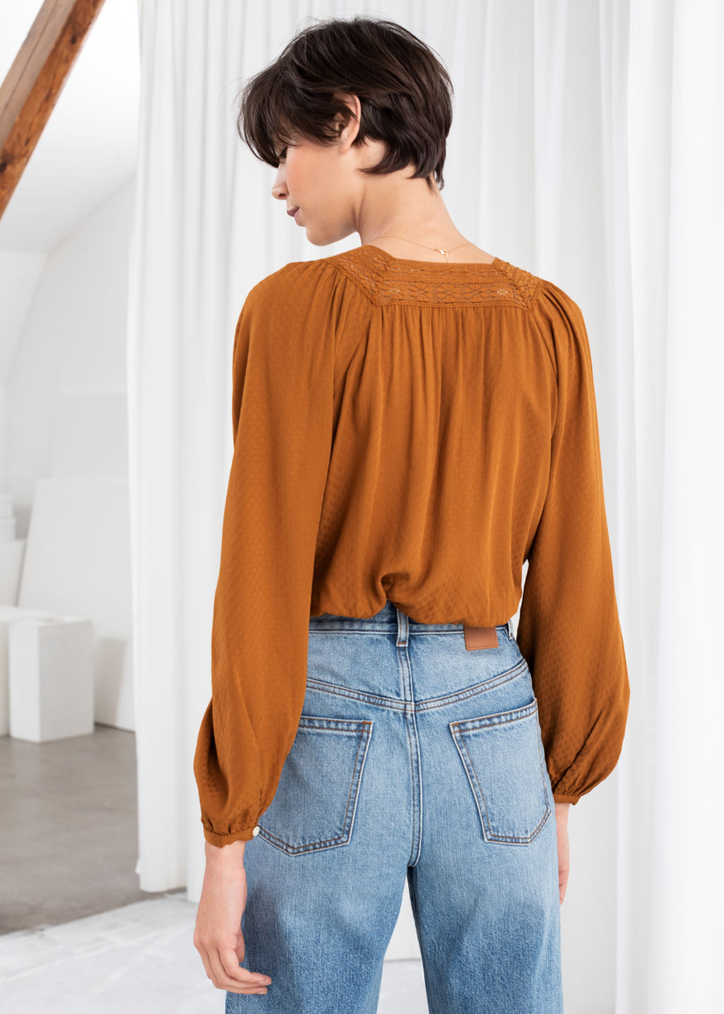 Model back image of Stories cropped lace trim peasant blouse in orange