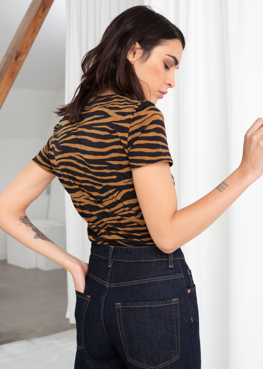 Model back image of Stories organic cotton zebra t-shirt in yellow
