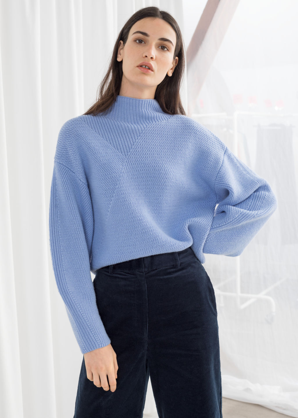Model front image of Stories wool blend mock neck sweater in blue