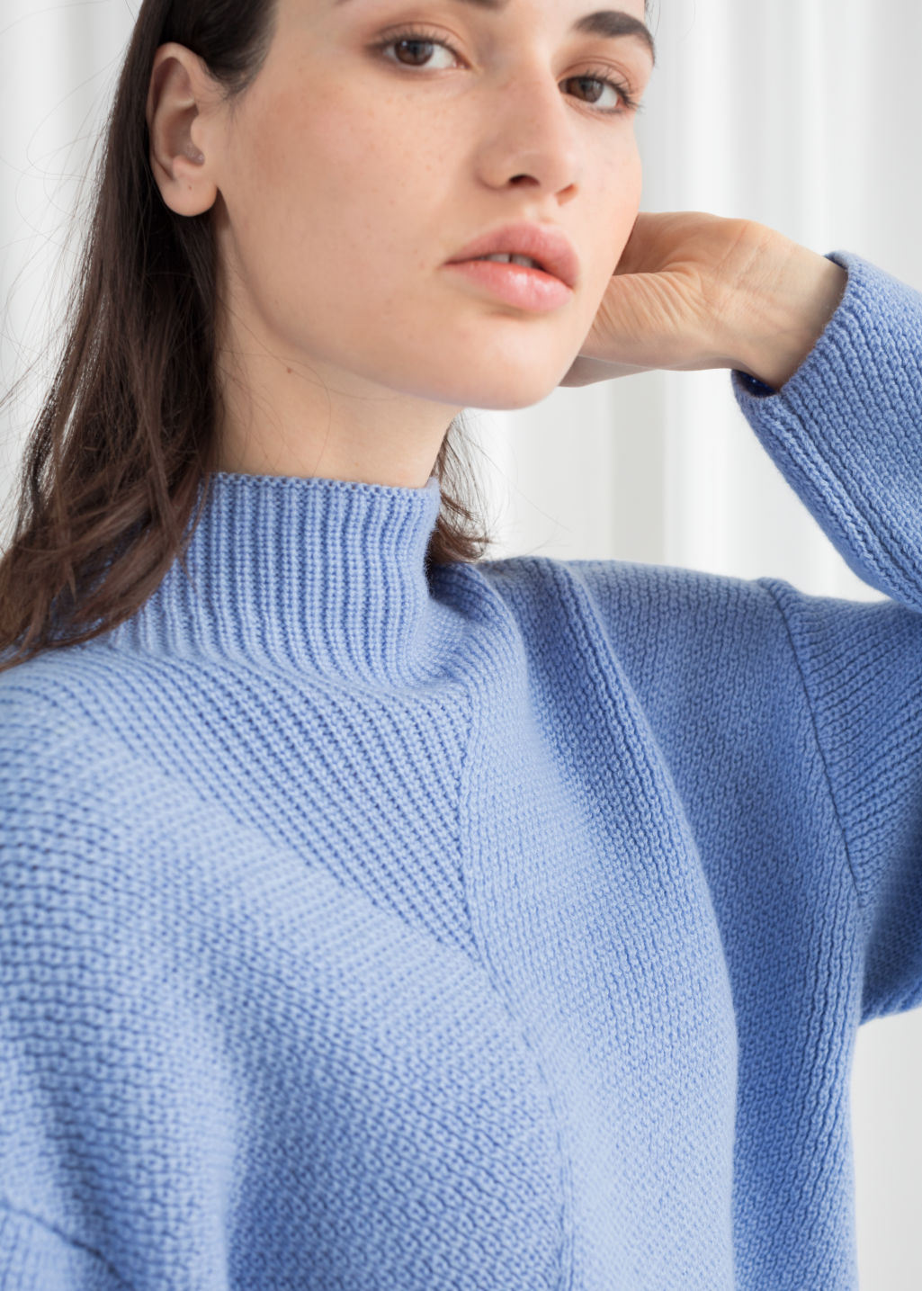 Model back image of Stories wool blend mock neck sweater in blue