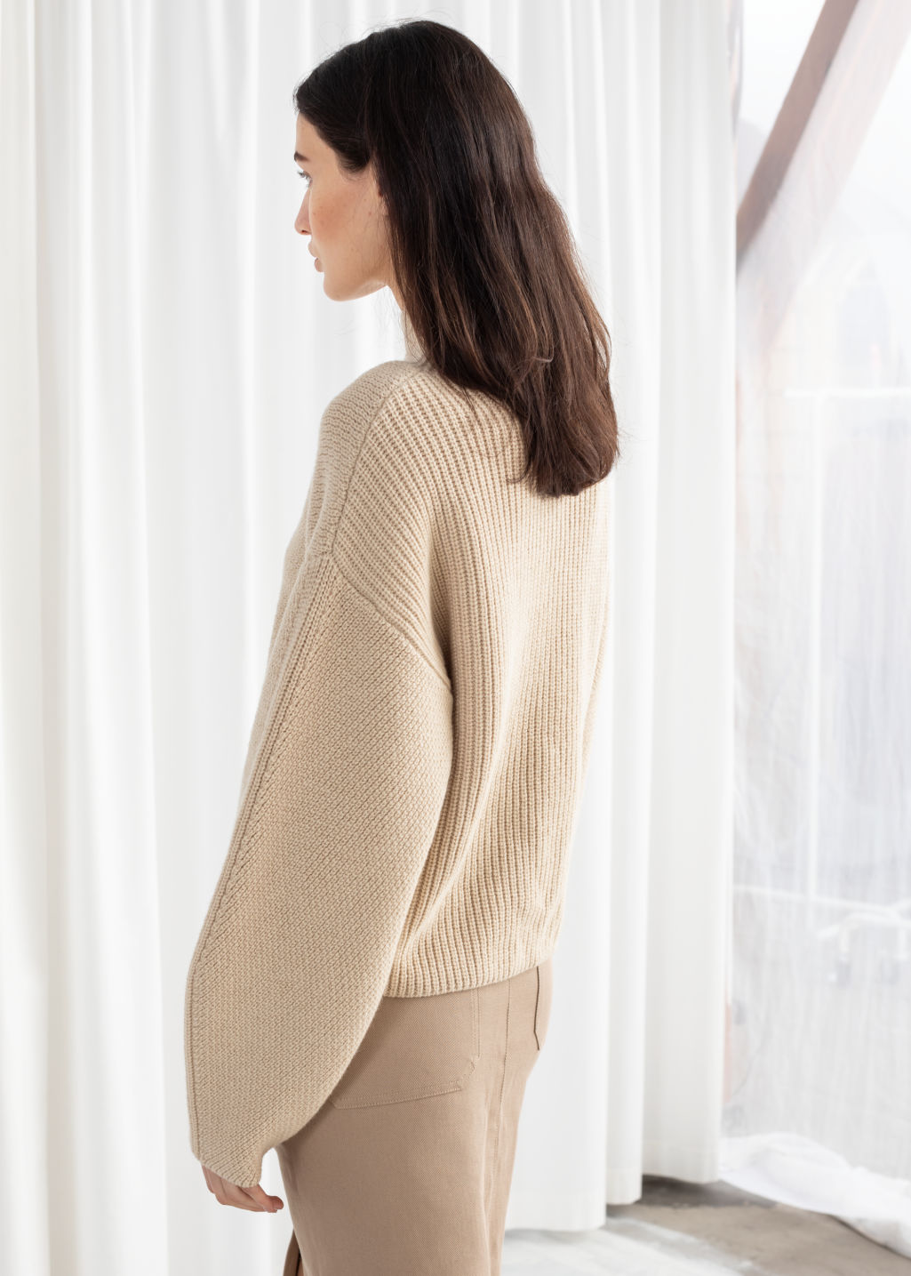 Model back image of Stories wool blend mock neck sweater in beige