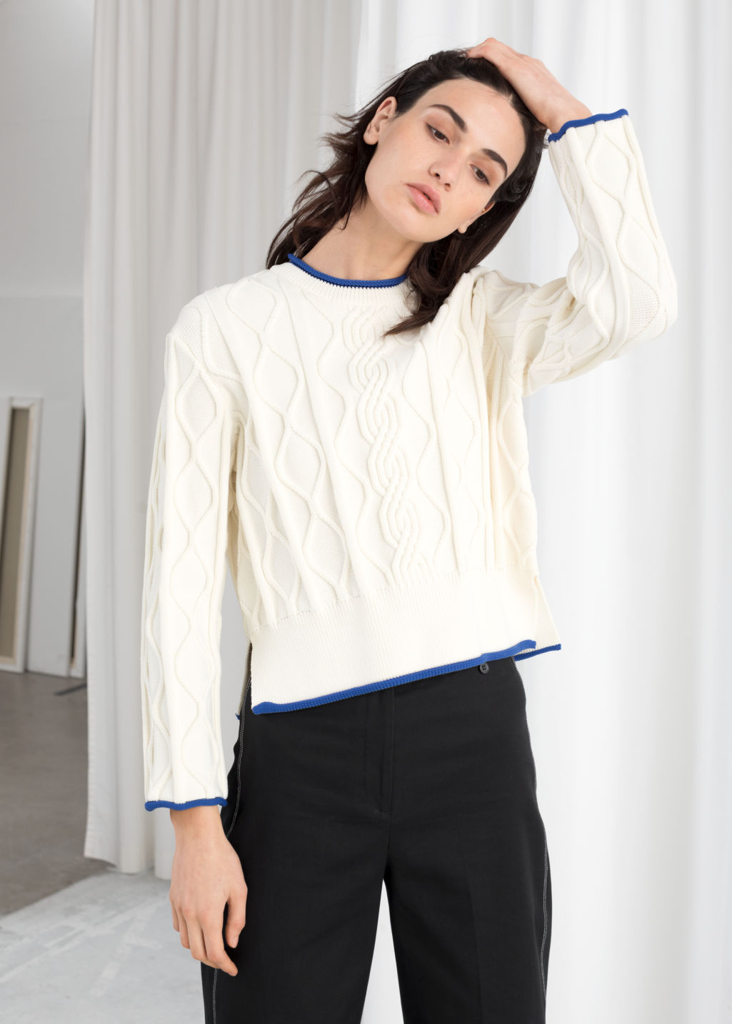Model front image of Stories structured cropped cable knit sweater in white