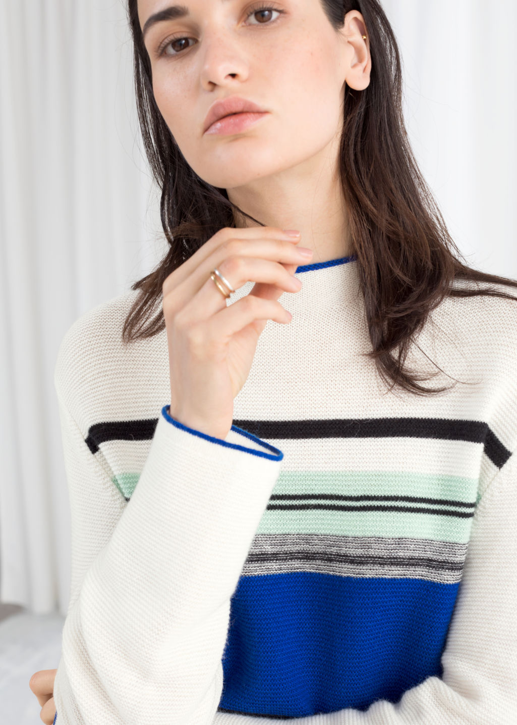 Model front image of Stories oversized striped wool blend sweater in white