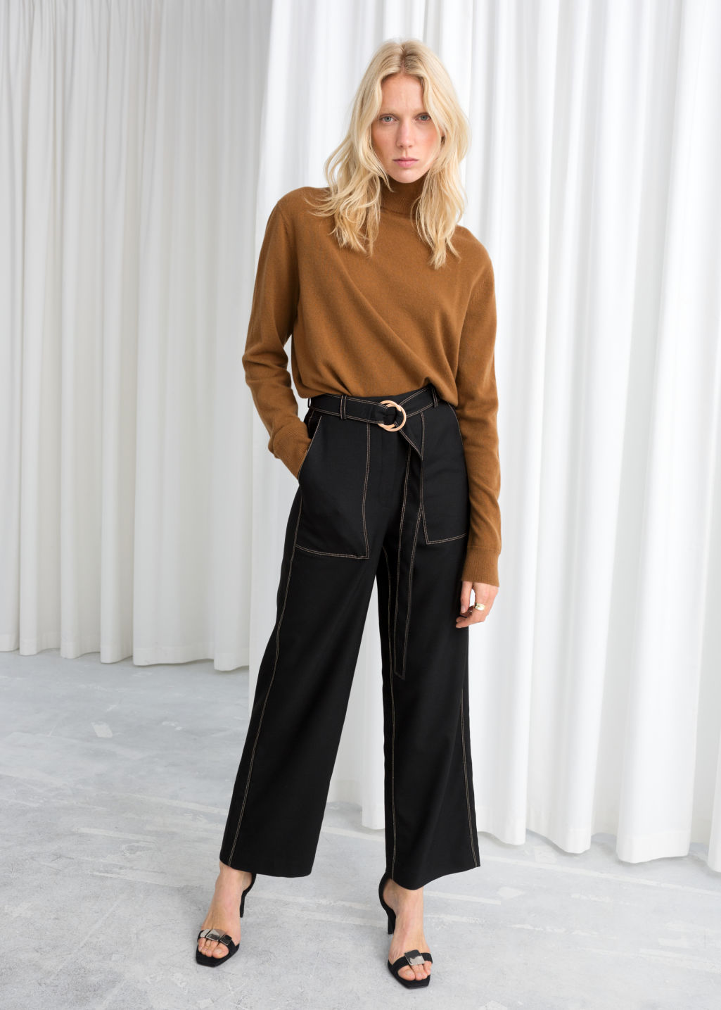 Model front image of Stories belted workwear trousers in black