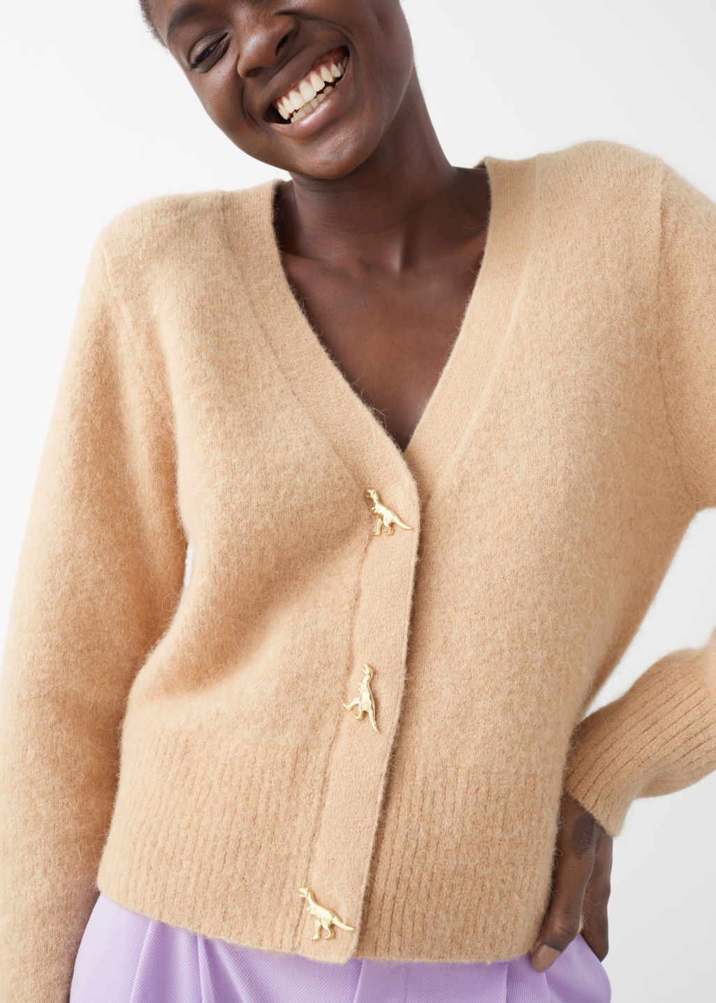 Model front image of Stories dinosaur button knit cardigan in beige