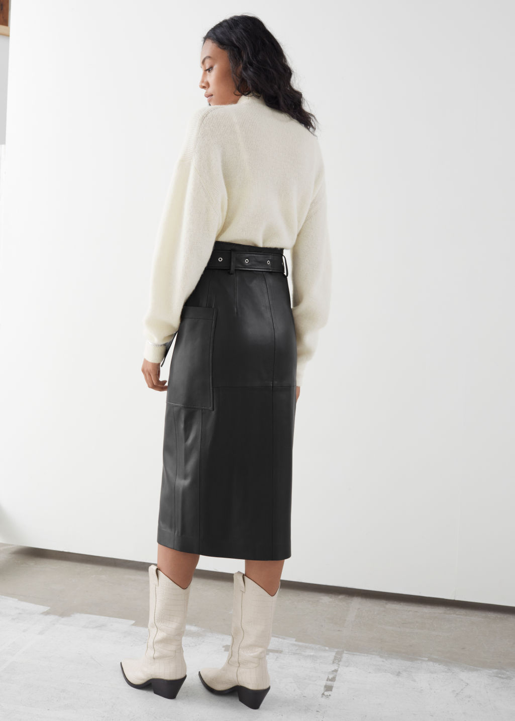 Model back image of Stories belted leather midi skirt in black