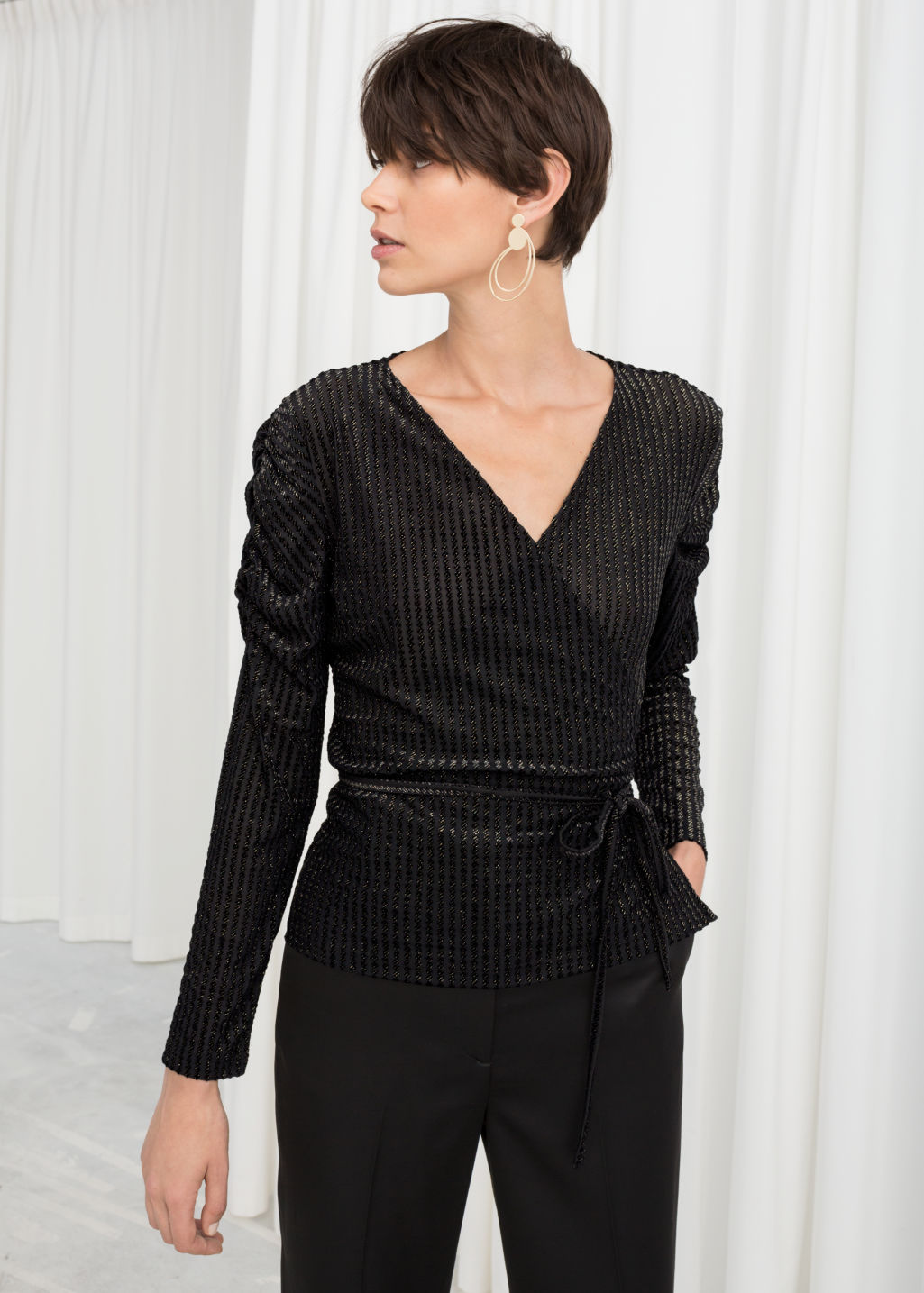 Model front image of Stories glitter stripe velvet wrap top in black
