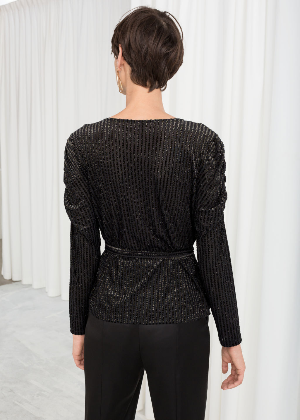 Model back image of Stories glitter stripe velvet wrap top in black