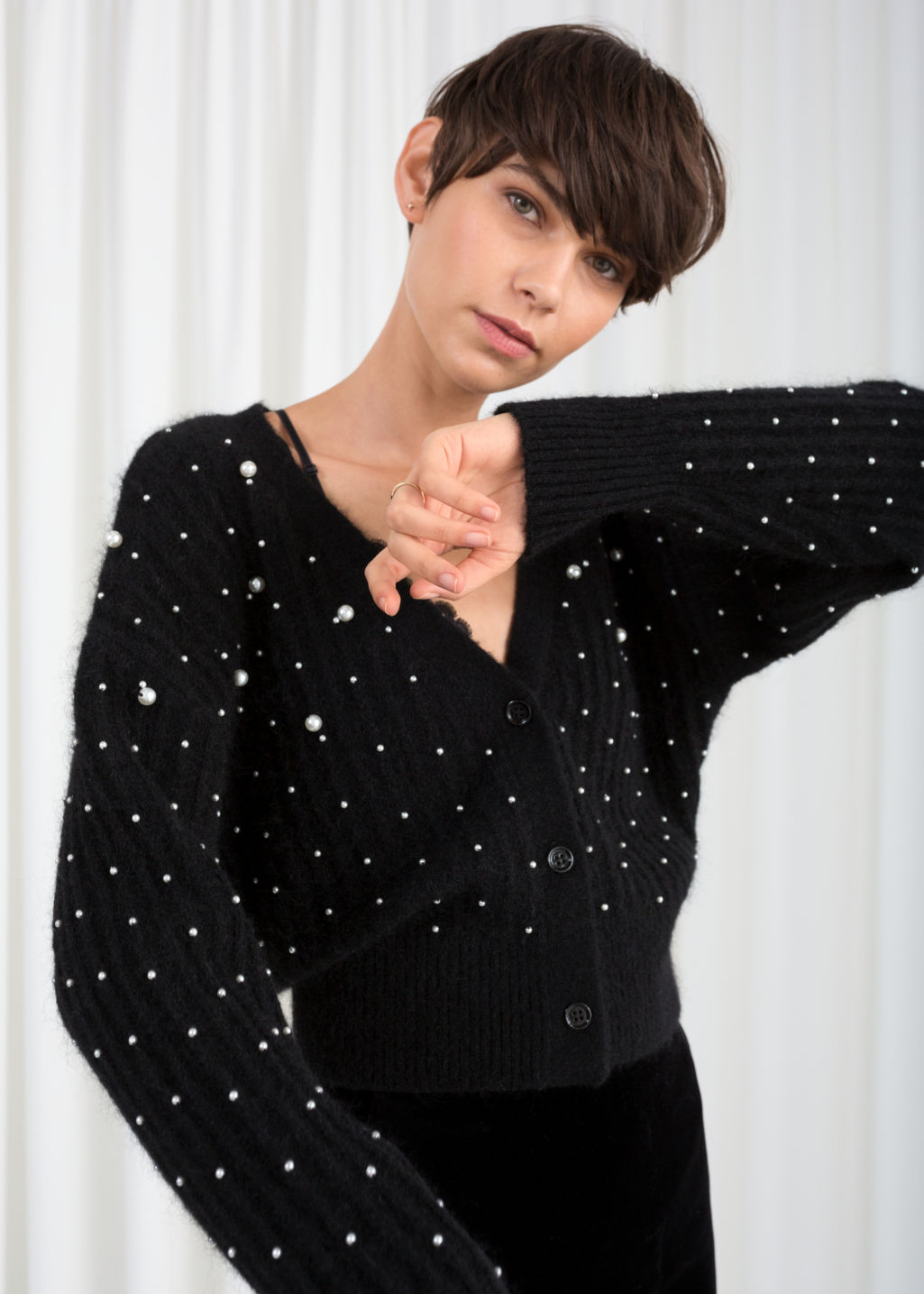 Model front image of Stories wool blend pearl cardigan in black