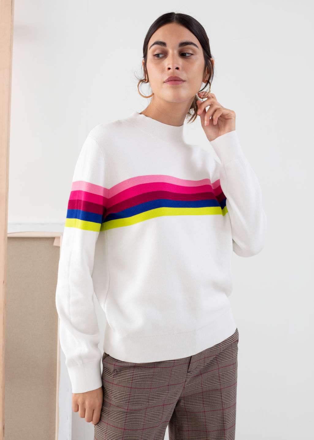 Model front image of Stories rainbow stripe pullover in white
