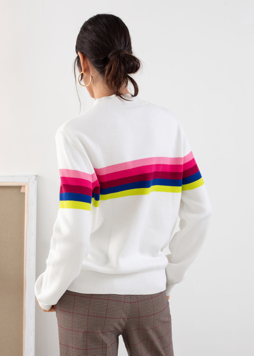 Model back image of Stories rainbow stripe pullover in white