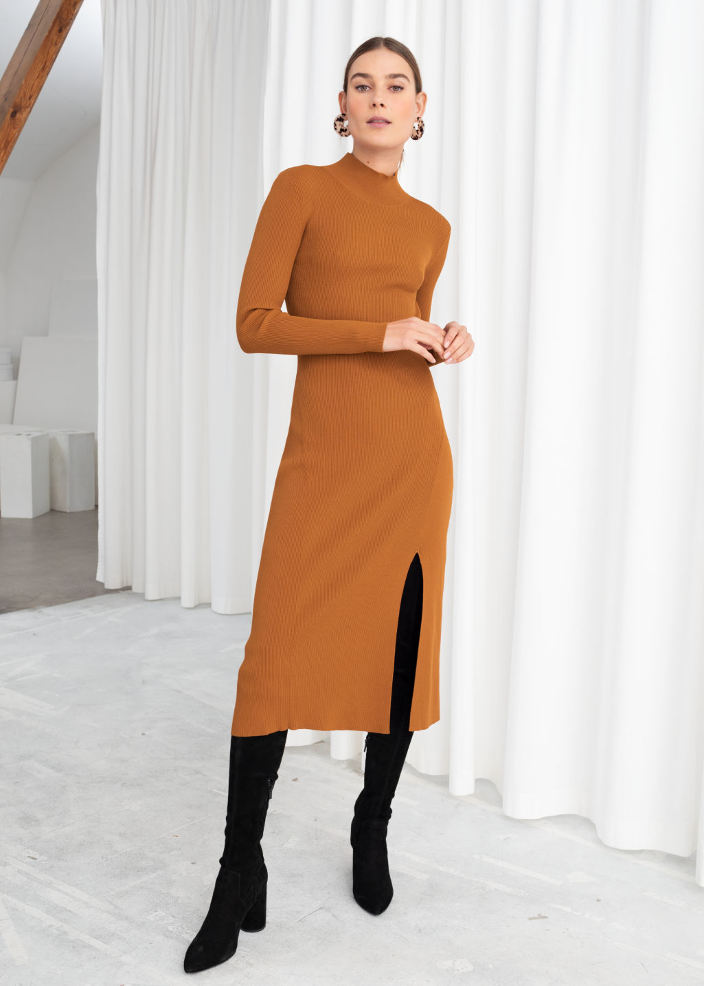 Model front image of Stories ribbed turtleneck midi dress  in orange