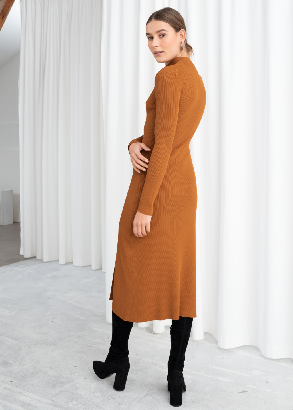 Model back image of Stories ribbed turtleneck midi dress  in orange