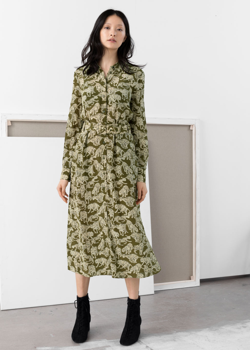 Model front image of Stories belted midi dress in green