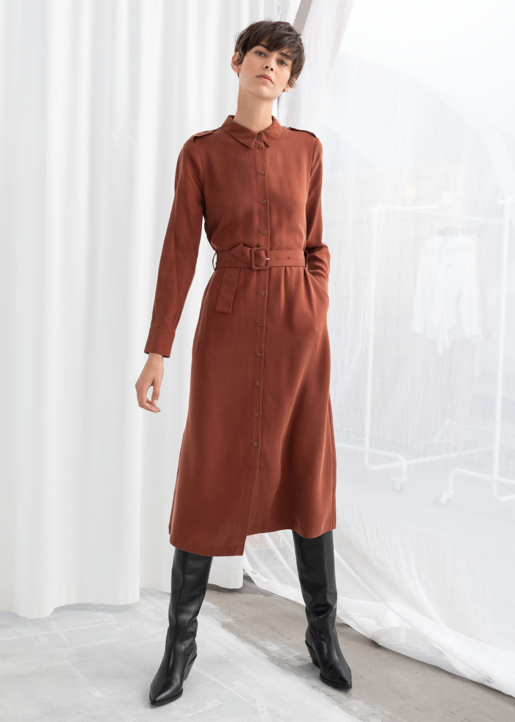 Model front image of Stories belted midi dress in orange