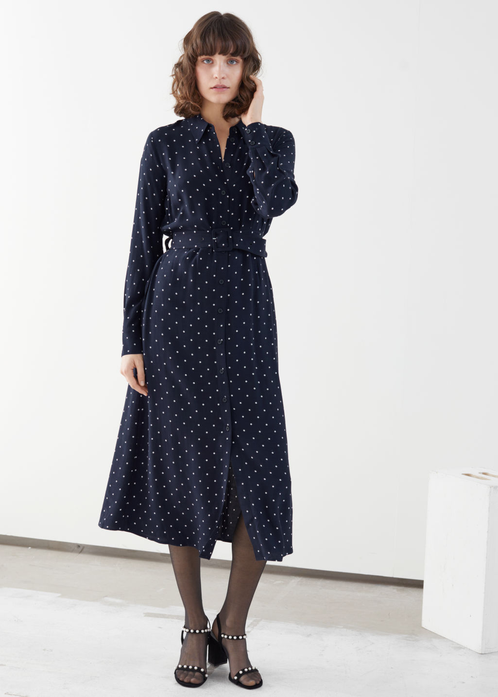 Model front image of Stories belted midi dress in blue