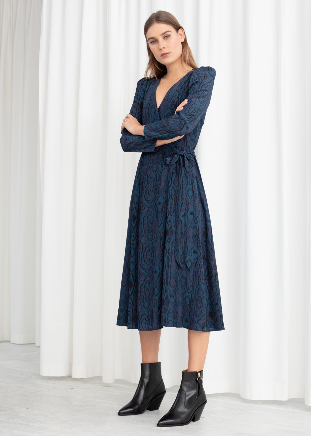 Model front image of Stories wood jacquard midi wrap dress in blue