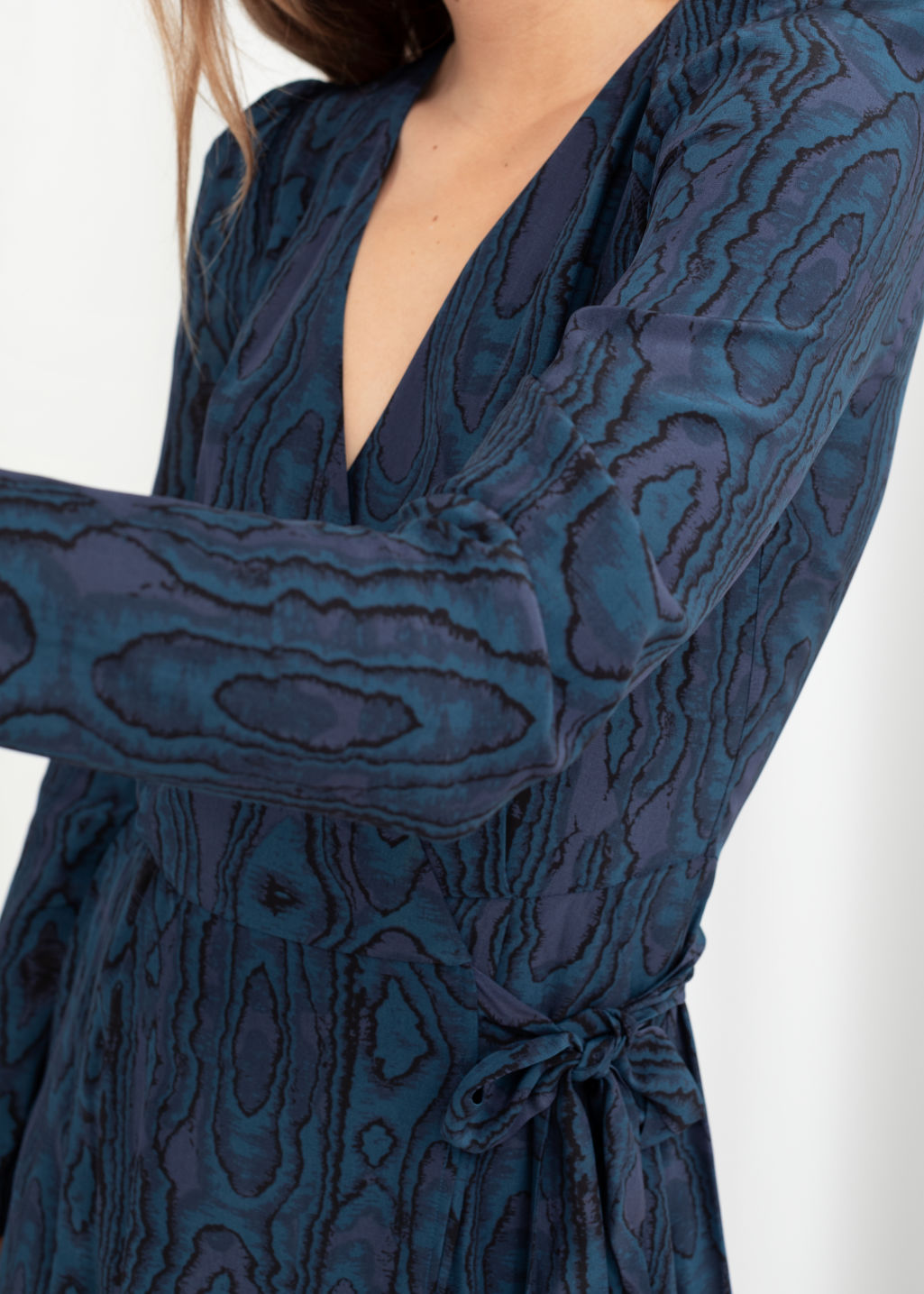 Model back image of Stories wood jacquard midi wrap dress in blue