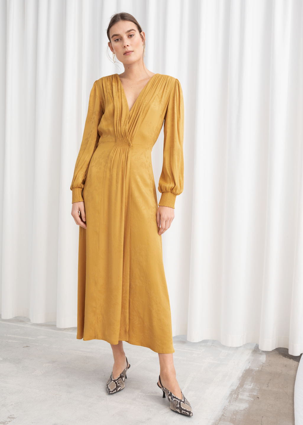 Model front image of Stories ruched jacquard midi dress in yellow