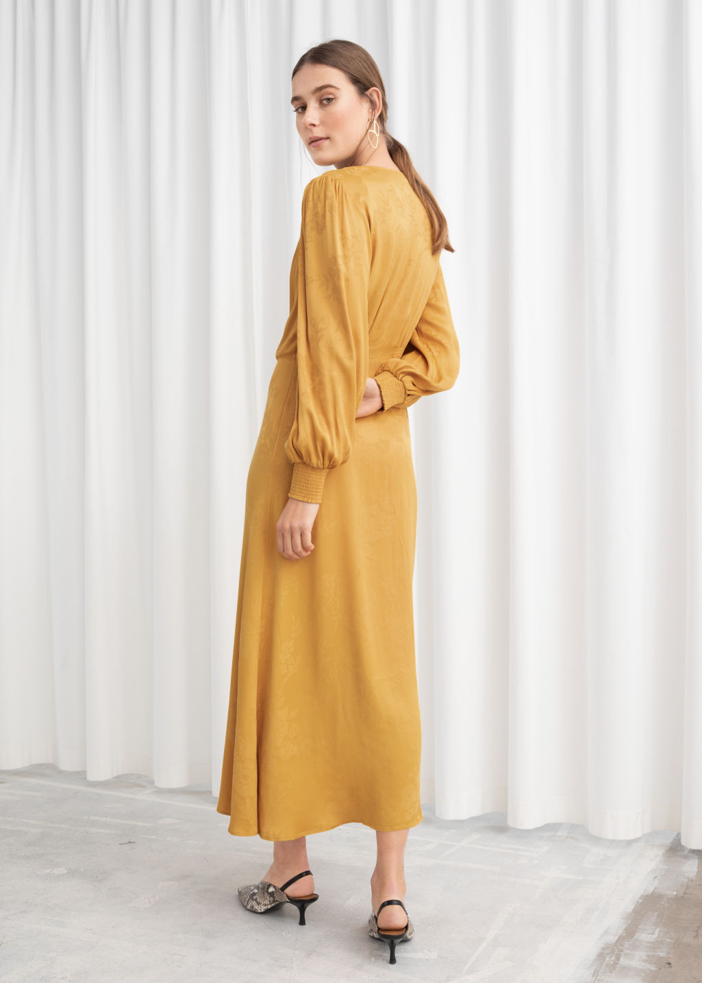 Model back image of Stories ruched jacquard midi dress in yellow